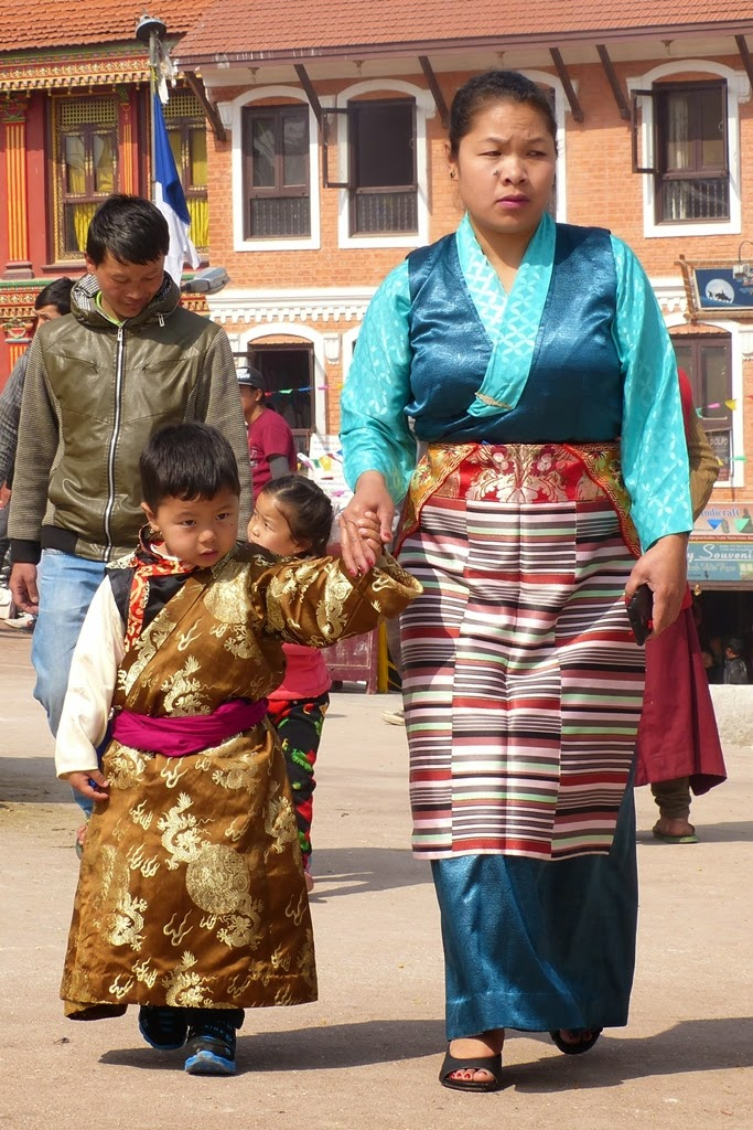 Mother and child wearing traditional Tibetan clothes