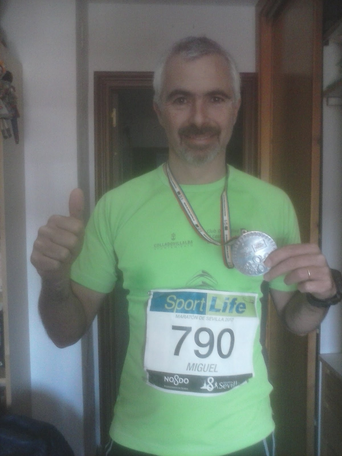 Con la medalla de Finisher