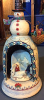 http://winnieswishauction.blogspot.com/2015/11/item-39-jim-shore-snowman-with-basket.html