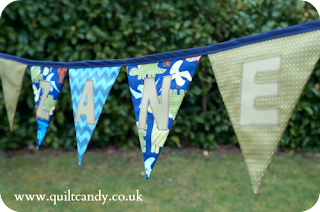 Urban dinosaur bunting by www.quiltcandy.co.uk