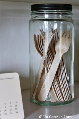 Wooden kitchen utensils 'Milk and Paper' in an old glass jar