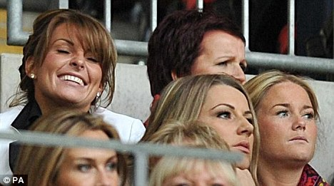 Coleen Rooney plays supportive wife as husband Wayne scores Man Utd's only goal as they lose to Barca