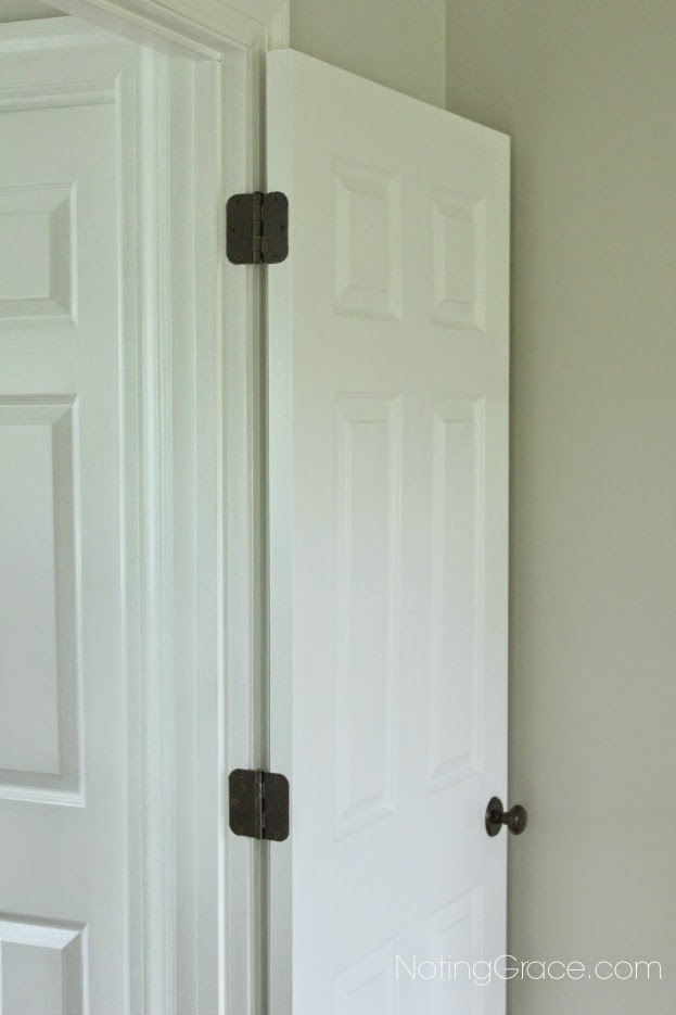 Spray painting door knobs and hinges and changing out dated outlets and light switches is an easy and inexpensive way to bring a house up to date.