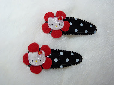 black polka dot hello kitty candy