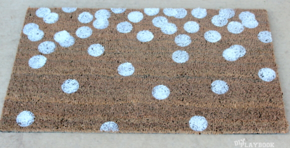 white polka dot doormat - I love the look of the white dots.
