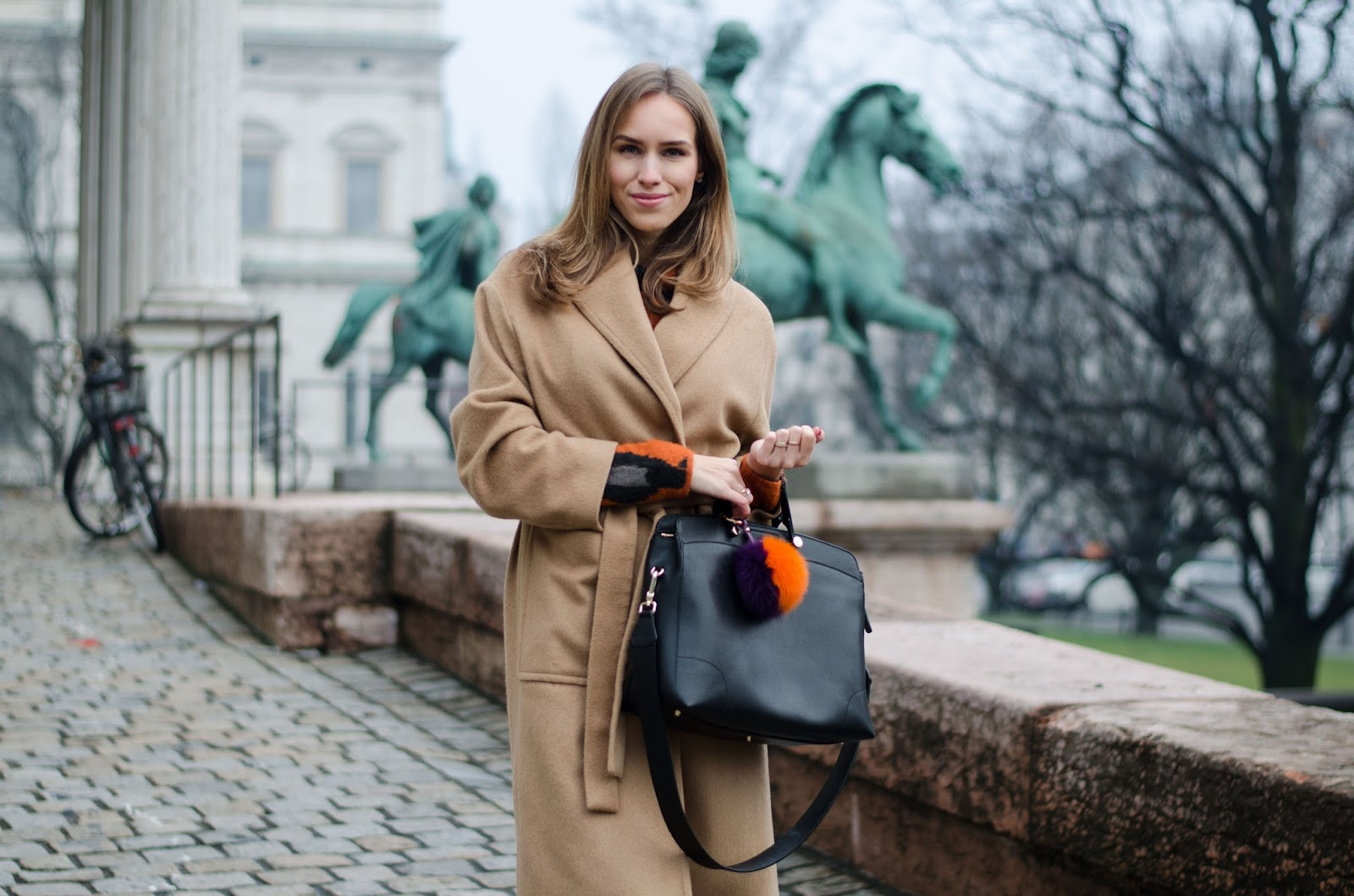 kristjaana mere brown belted coat black bag winter style