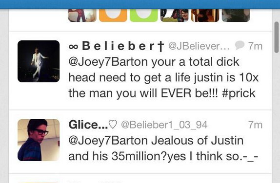 A snapshot from Joey Barton's Twitter timeline showing his conflict with Justine Bieber's fans