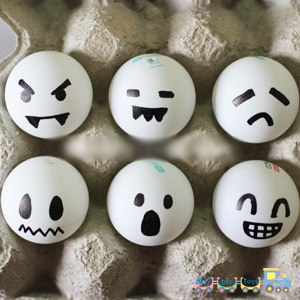 Handmade Halloween ghosts from ping-pong balls