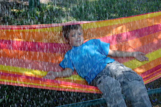 summer storm appears while grandson plays outdoors