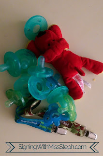 pile of no longer needed pacifiers