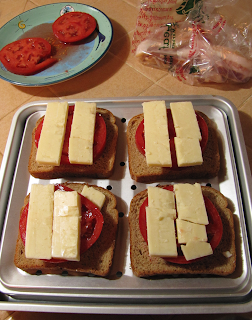 Stacking up Bread, Tomatoes, Cheese, and Bacon