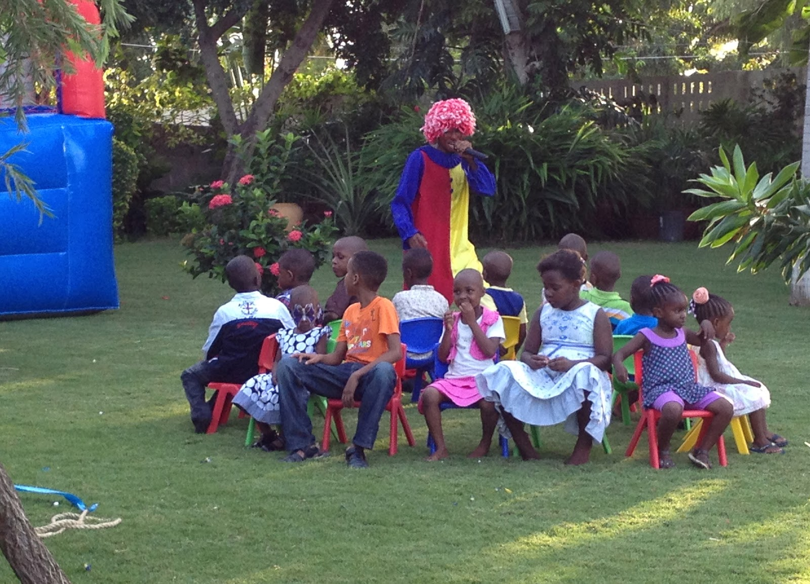 Musical chair game for kids - Clown Leading Kids Through Different Games Here They Were Playing A Musical Chair Game