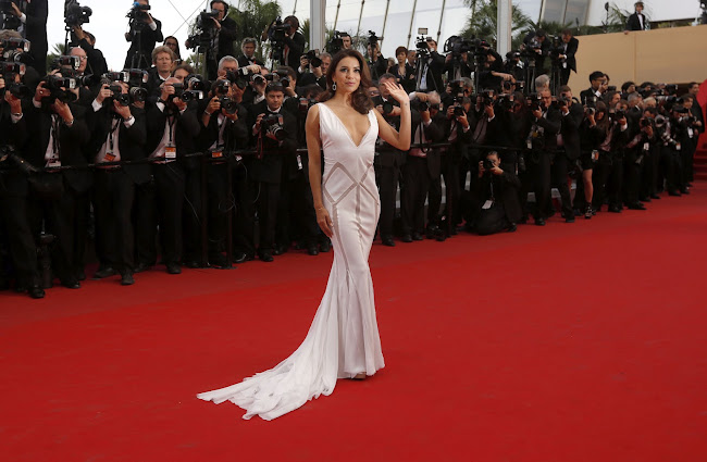 EVA LONGORIA waves to the fans at Cannes Film Festival 2012 red carpet