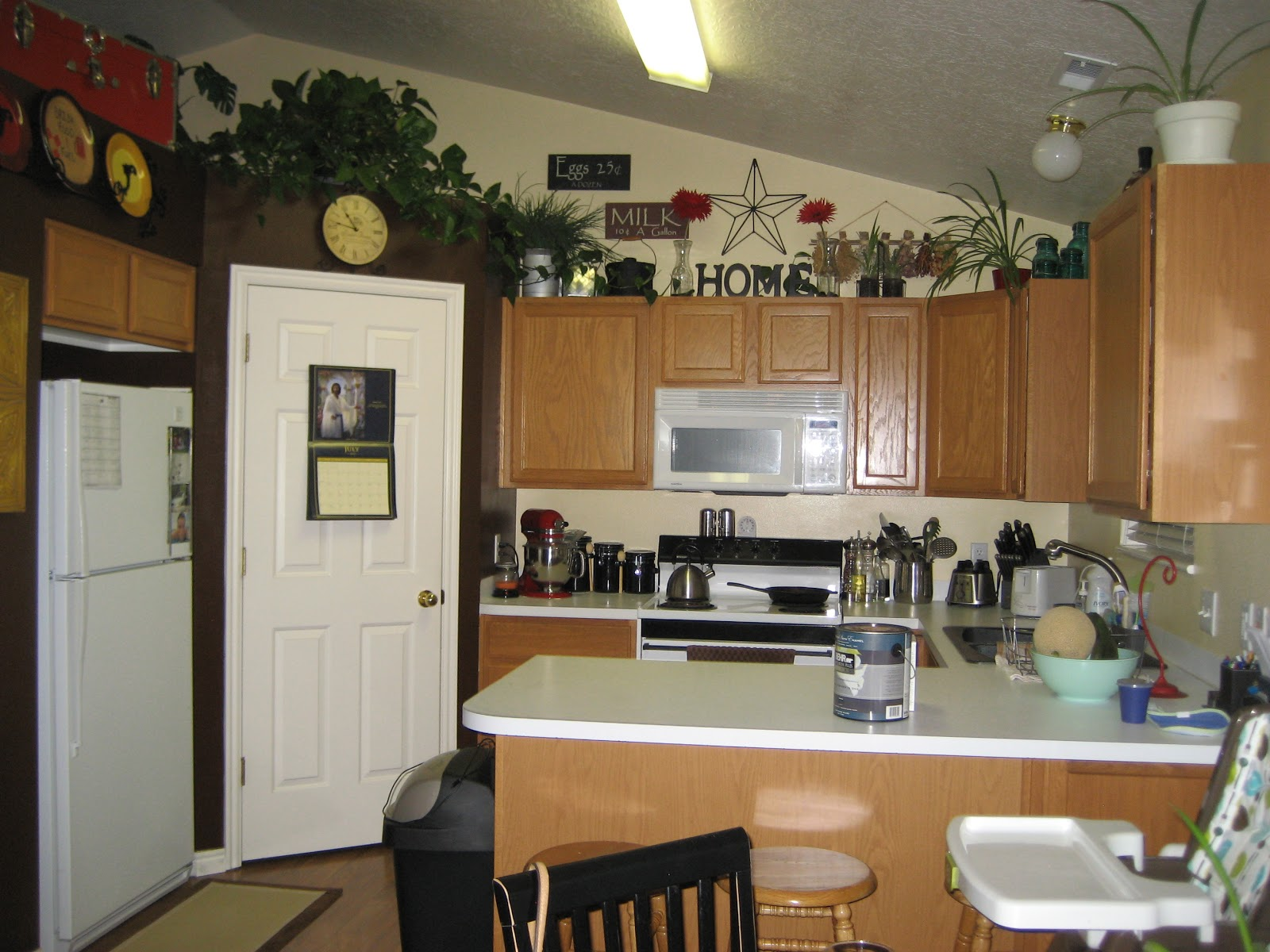 Above Kitchen Cabinet Decorations - Space above kitchen cabinet decorating ideas