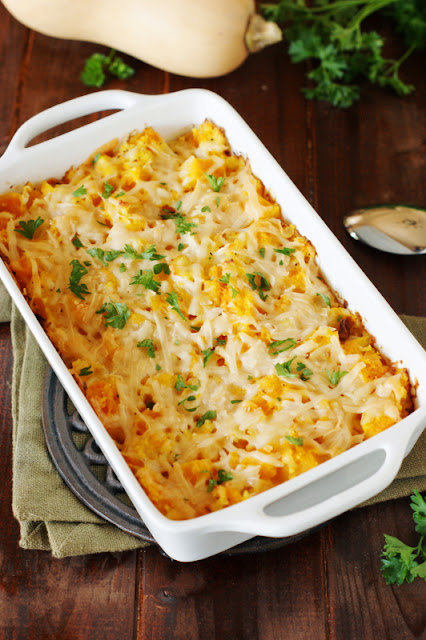 Butternut Squash Gratin ~ an easy, cheesy way to enjoy this delicious winter squash.  Can be made ahead for added convenience!   www.thekitchenismyplayground.com