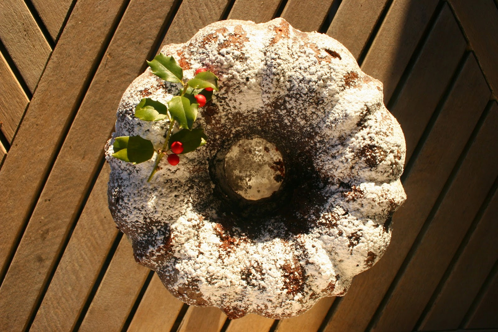 Whiskey-Soaked Dark Chocolate Bundt Cake with holly