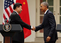 China's President Xi Jinping (L) and U.S. President Barack Obama shake hands at the end of a joint news conference in the Rose Garden at the White House in Washington September 25, 2015. (Credit: Reuters/Gary Cameron) Click to Enlarge.