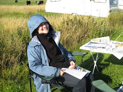 Lola II in field with newspapers