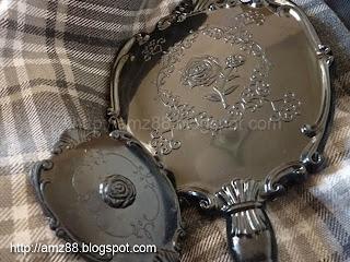 http://amz88.blogspot.com/2011/06/mirror-mirror-ala-anna-sui.html