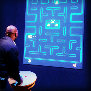 playing Pac-Man at the Art of Video Games exhibit