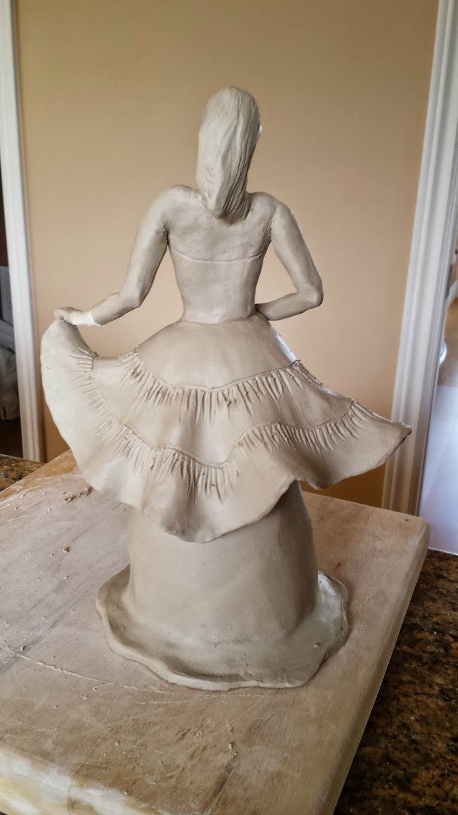 Ceramic sculptural piece - lady in ball gown - prior to raku firing.