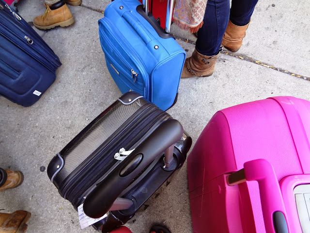 Black, blue and pink suitcases.
