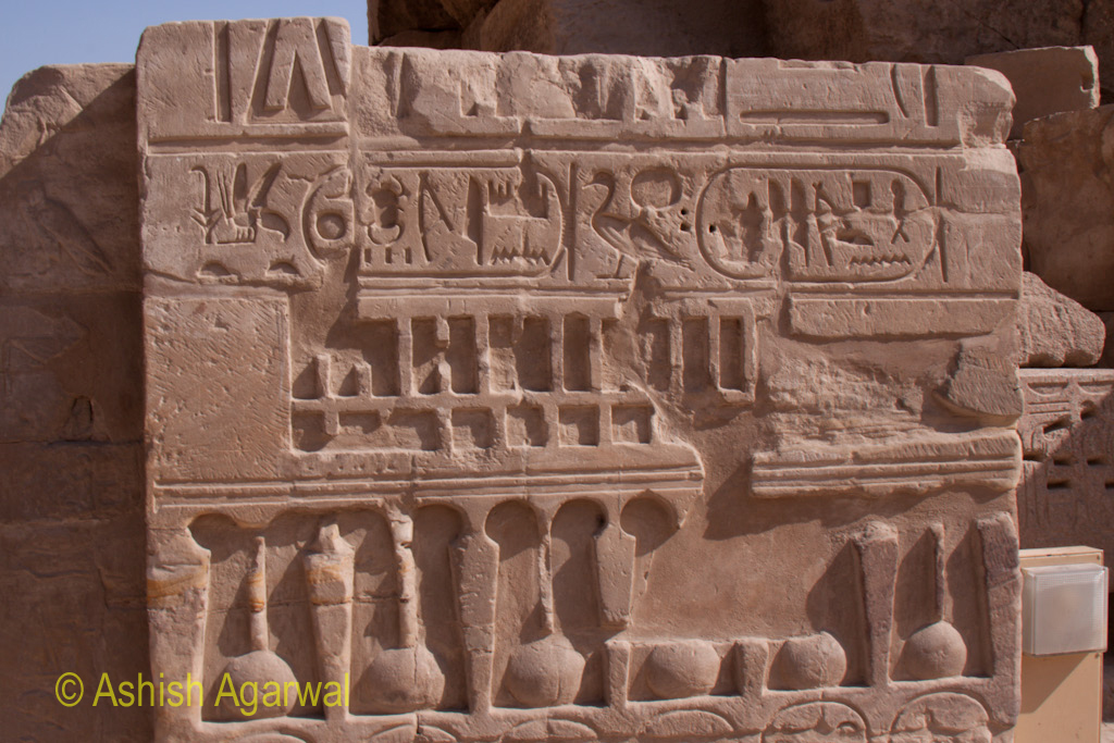 Block with large amount of carvings inside the Karnak temple in Luxor