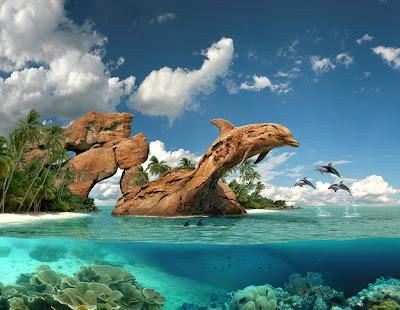 Delfines saltando en las aguas de color turquesa (Mar Azul)