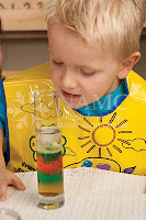 young boy looking at water experiment NAMC montessori parent why choose montessori for my children