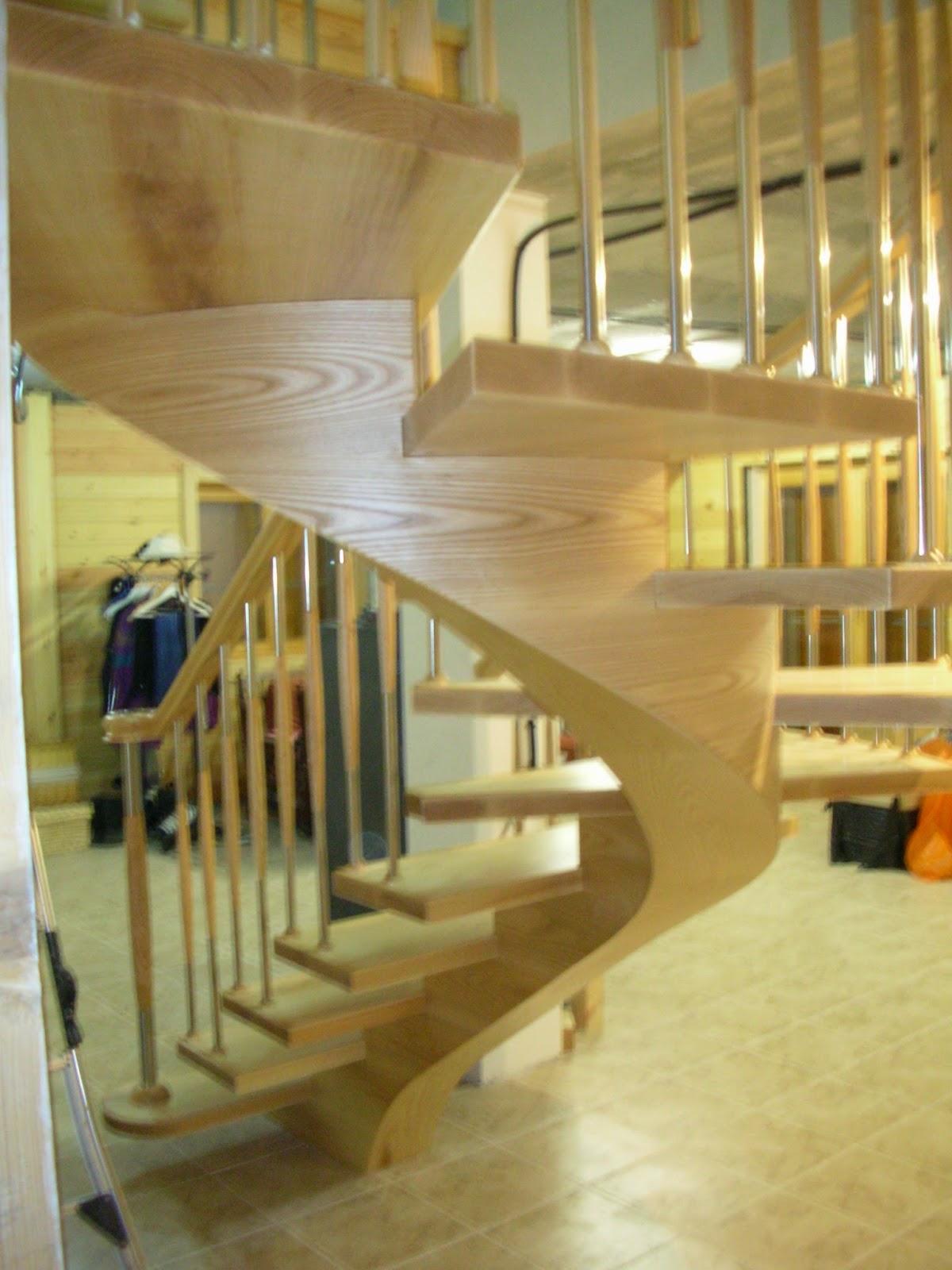 Escaleras y pasamanos escalera de zanca central helicoidal for Escaleras 7 escalones