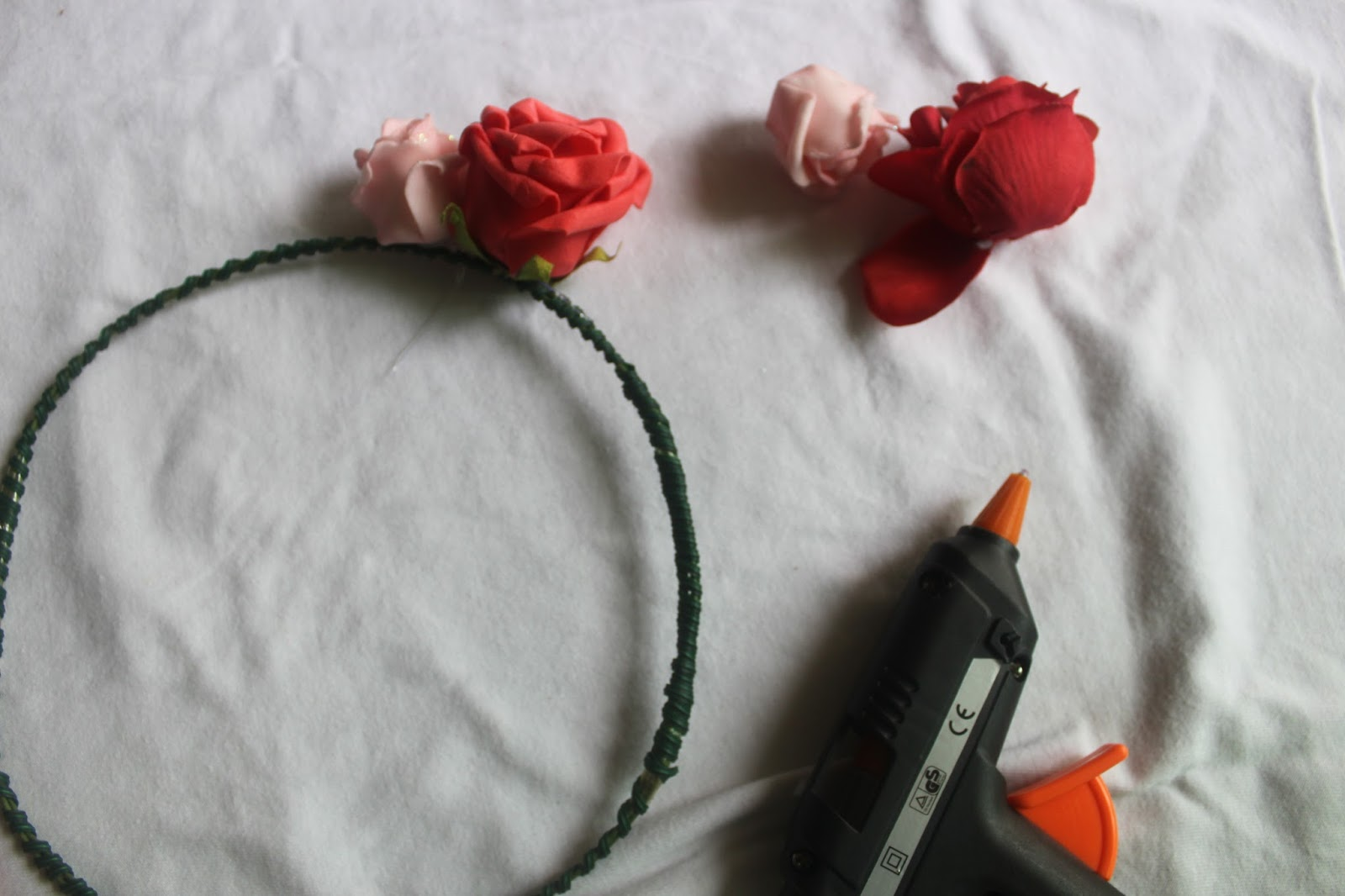 Originalrchi diy flower crown step 6 just shoot press out the glue from the gun onto the wire and just nicely stick the flowers on accordingly dont be shy go wild with your izmirmasajfo Image collections