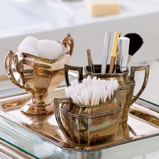 A Vintage Tea Set Is Now Used To Store And Hold Makeup Brushes And Cotton Pads Creating An Elegant Addition To A Bathroom Or Bedroom Vanity