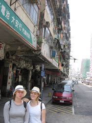 Girls in front of low level building.