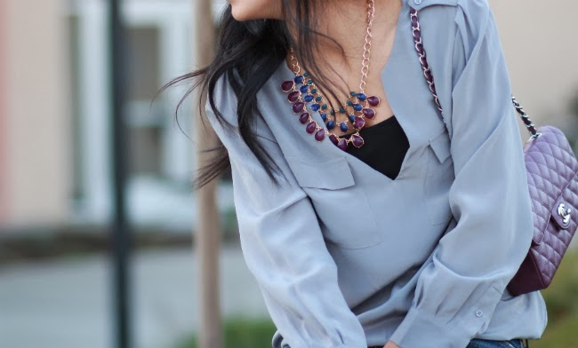 statement purple necklace silk blouse