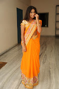 Midhuna New photo session in Saree-thumbnail-5