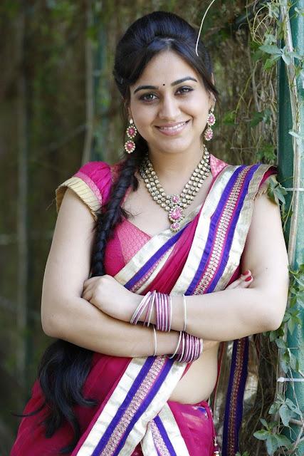 Aksha in half saree stills