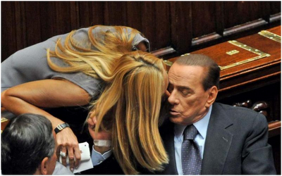 A tender kiss given by blonde - and young - Roberta Biancofiore to Silvio Berlusconi, in the Italian House of Parliament