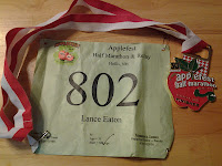 Lance Eaton's racing number and medal for his first half-marathon.