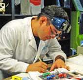 photo - Ken Mazur, presenter of a Blitz QFD case study for an elementary school, 2012 Symposium on QFD
