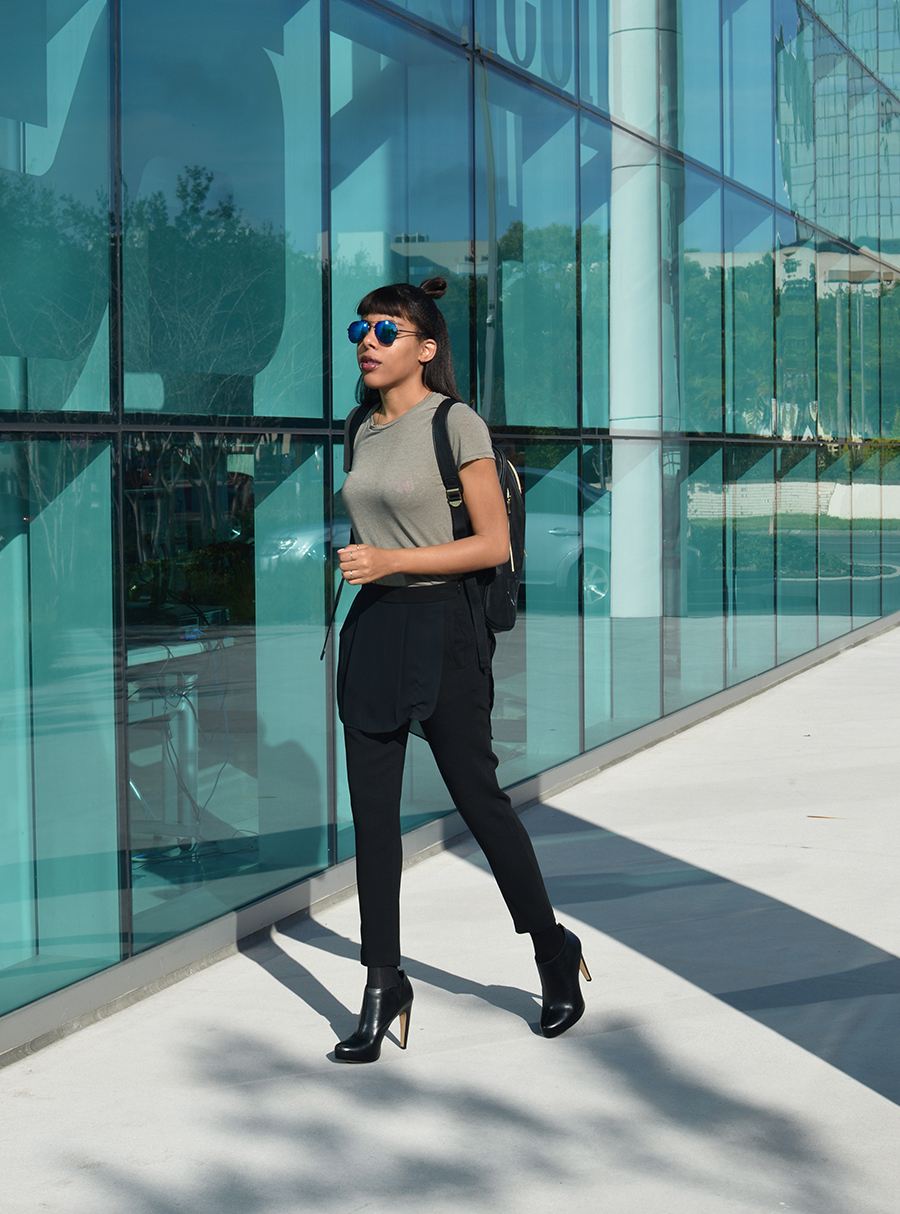 Minimalist Indie Fashion blogger Anais Alexandre of Down to Stars in BCBG pants with Sam Edelman boots walking around Sarasota Florida