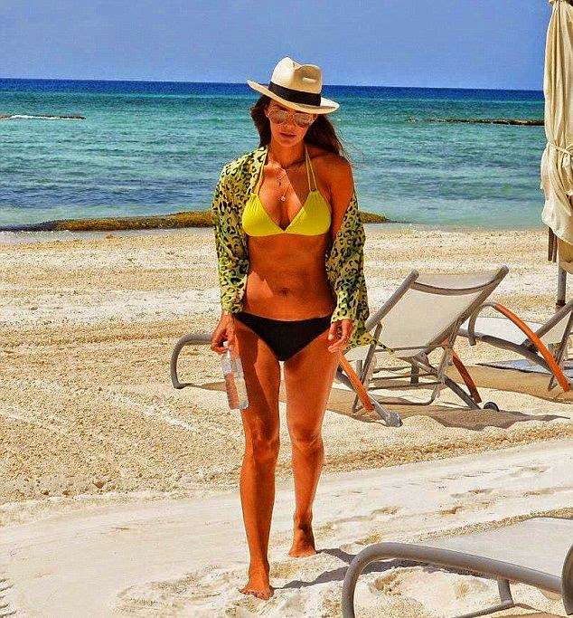 The former Miss USA was spotted to celebrating her Birthday at the Grand Velas Riviera Maya Resort in Playa Del Carmen, Mexico on Friday, July 4, 2014, with the lovely choosing a string bikini to end all one-piece and two-piece tropical appearance.