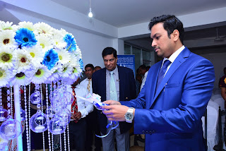 Dr. Hiran Hettiarachchi (MBBS-Colombo, MBA - Australia) - Group Chairman, Blue Mountain Group of Companies lights a ceremonial lamp to declare the branch open