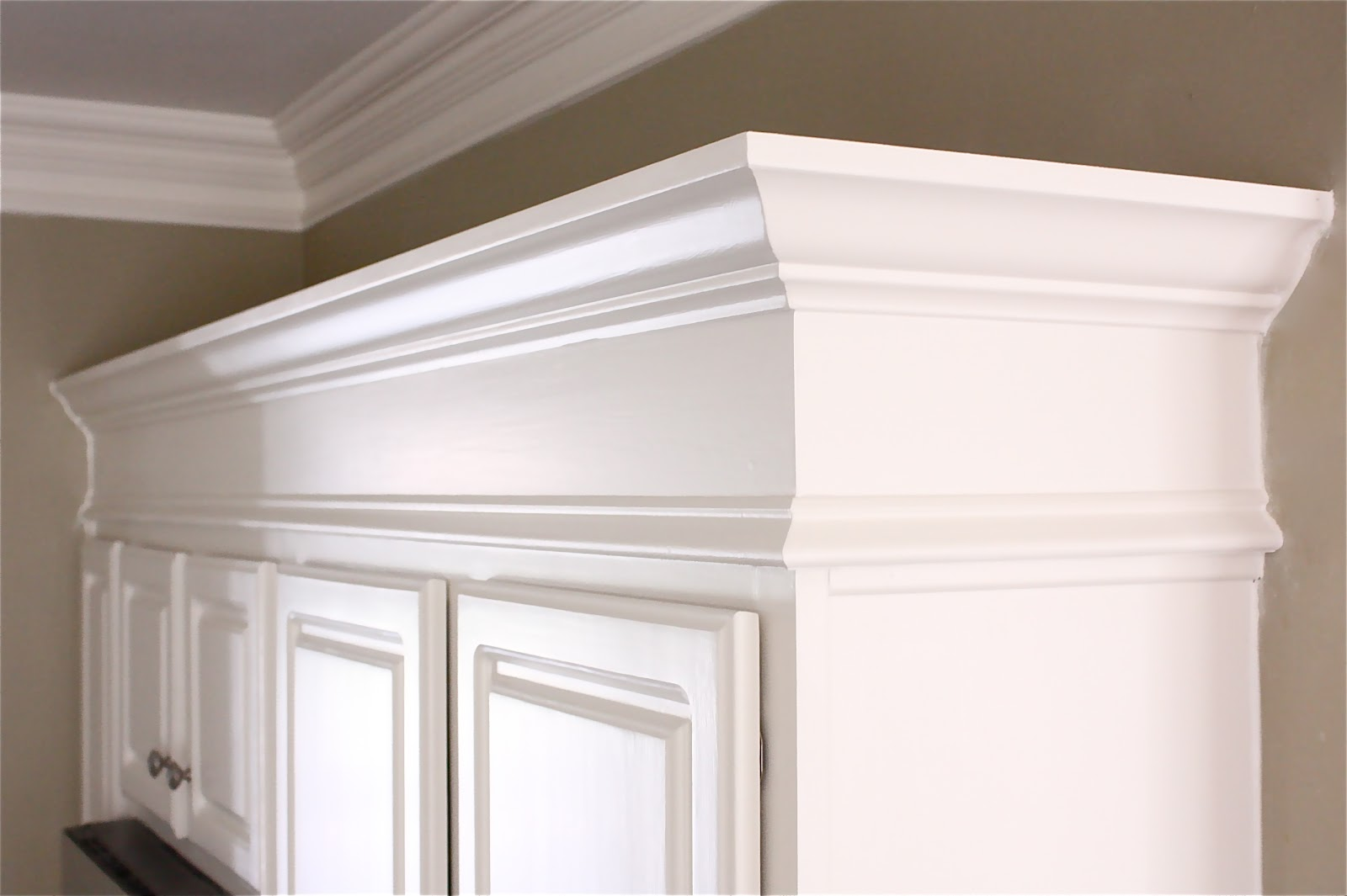 The yellow cape cod sub zero and wolf delicious design for Attaching crown molding to kitchen cabinets