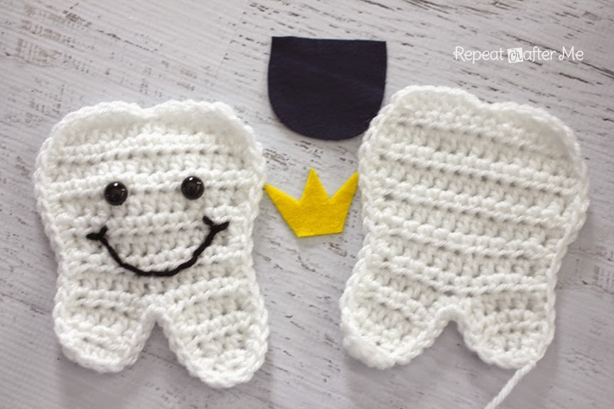 Stitch on the pocket to the other tooth you could use embroidery