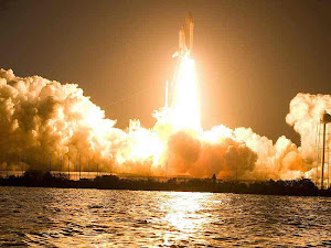 SPACE SHUTTLE DISCOVERY LIFTS OFF INTO A DARK SKY
