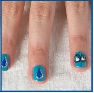 Nails Decorated with One of the Characters of Inside Out Film: Sadness.