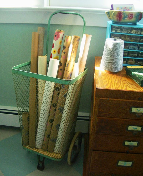 Vintage shopping cart used as wallpaper storage -  #craftroom #craftstorage #storage #craftsupplies