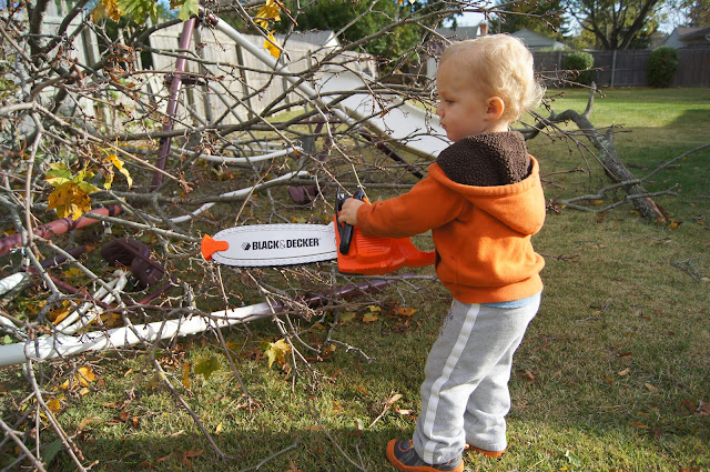 toddler with chainsaw