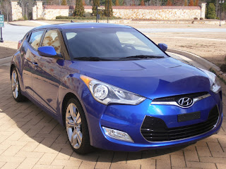 highlights the veloster is the only vehicle available in the market