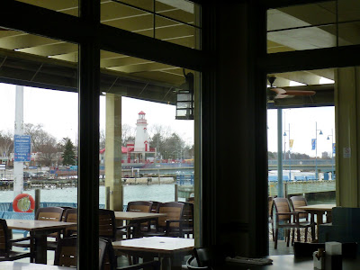 Landmark lighthouse across from dining room, patio at Snug Harbour.